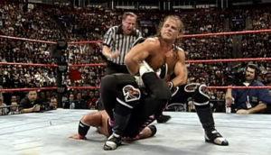 shawn-michaels-puts-bret-hart-on-sharpshooter-montreal-screwjob-wrestling-examiner