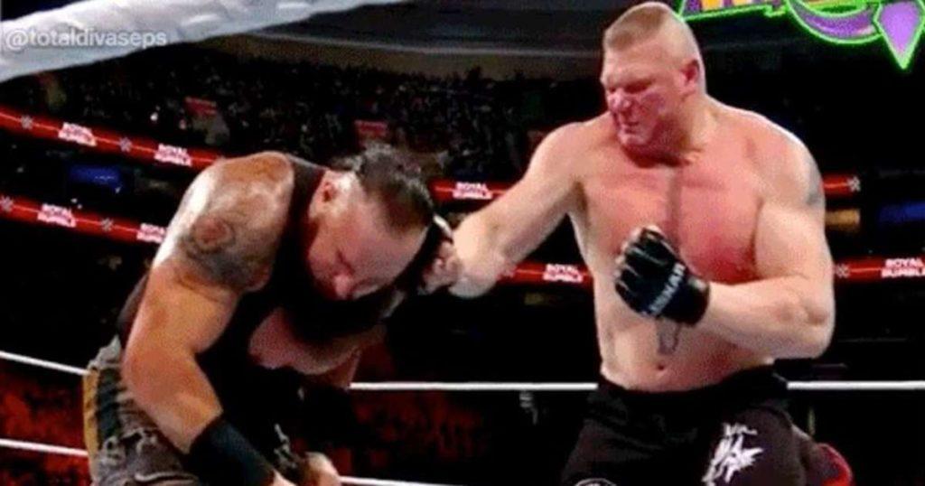 Brock Lesnar Punches Braun Strowman - Wrestling Examiner