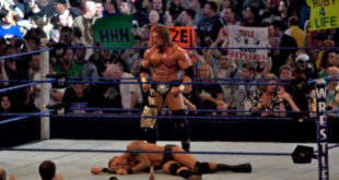 Triple H standing over Randy Orton - Wrestling Examiner